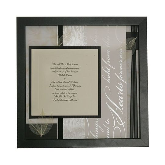 it perfectly matched the feel of the invitation. Textured paper in various shades of cream, red,...