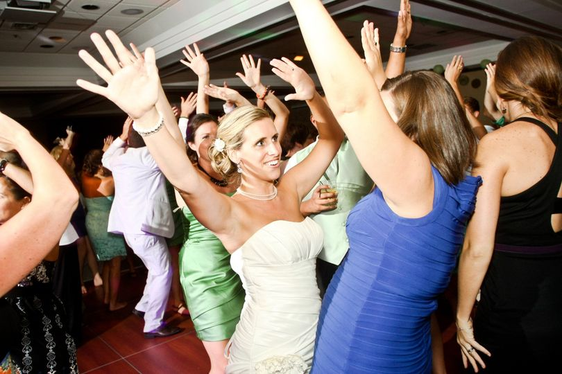 Guests throwing their hands in the air