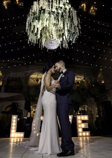 Couple photo under chandelier
