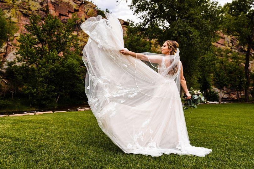 Bride tossing dress