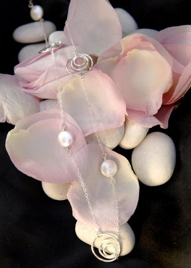consisting of white fresh water pearls, twisted Bali silver and Swarovski crystals with AB coating....