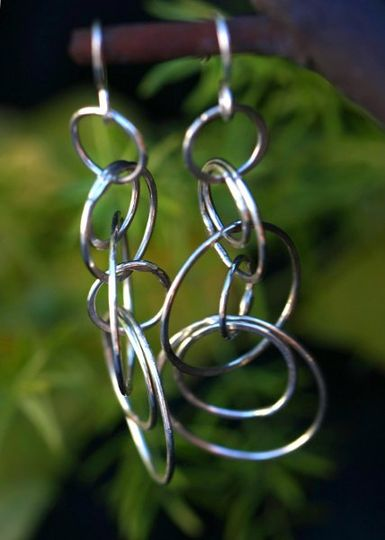 Olympia Earrings are white teardrop pearls with Sterling silver lever backs. The natural curvature...
