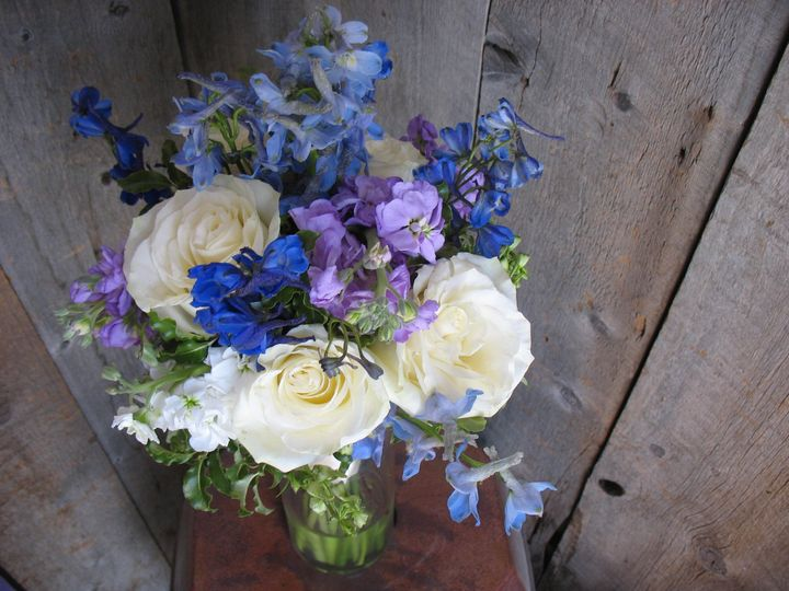 White roses with blue delphinium and lavender stock