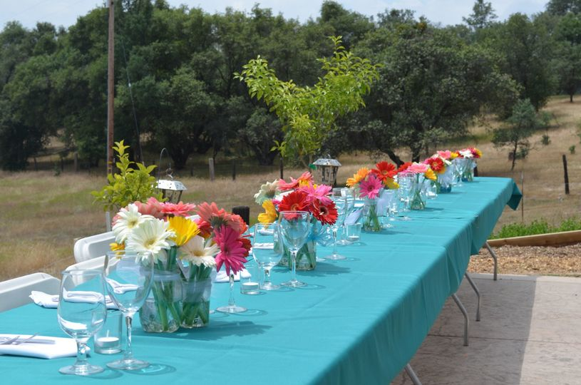 Head table setting with flower centerpiece