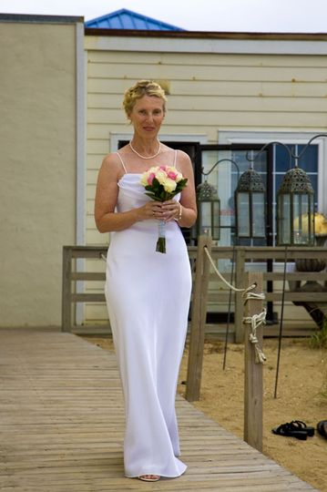Bride walking down the dock