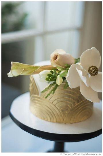Mid-Century design wedding cake top tier with 14k gold painted decor and sugar flowers