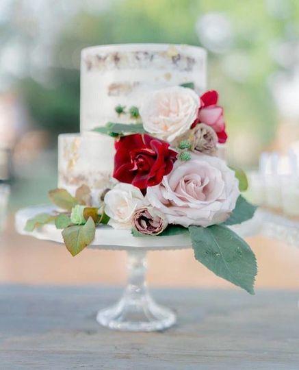 Petite, naked cake with fresh flowers