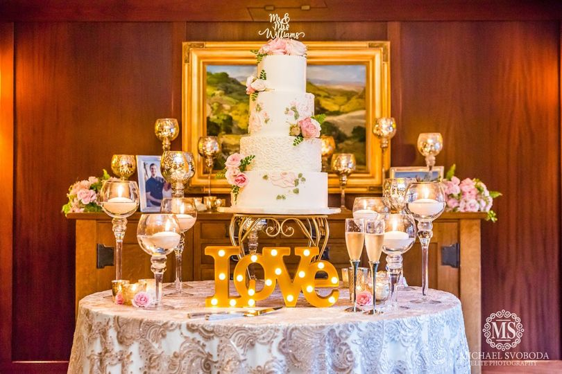 Elegant wedding cake with hand painted buttercream and flowers, at The Lodge at Torrey Pines