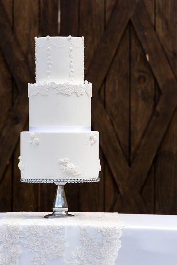 All white wedding cake, lace