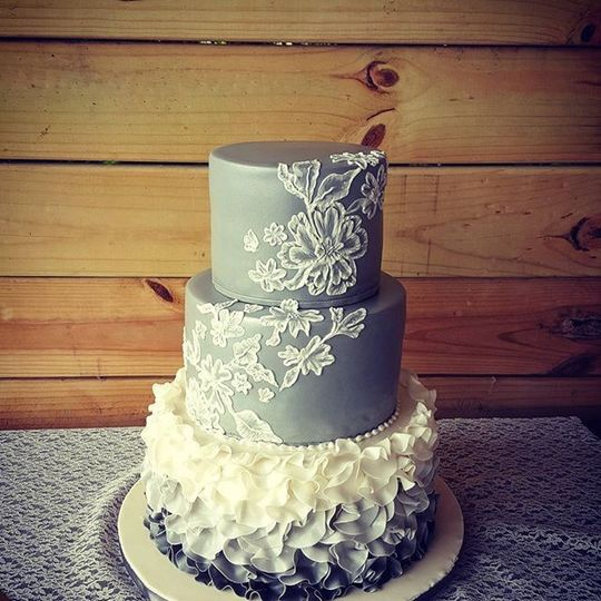 Blue wedding cake with white lace piping