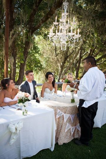 800x800 1381874992026 leon serving bride and groom first meal as husband and wife