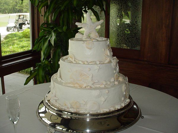 Wedding cake: Buttercream cake accented with fondant sea shells. Reception held at Brunswick Country...