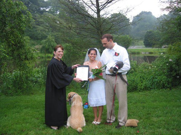 Newlyweds, their dog, and their officiant