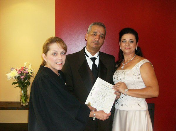 Officiant, groom, and bride