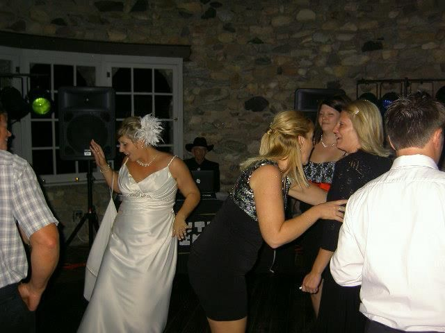 The bride with their guests dancing