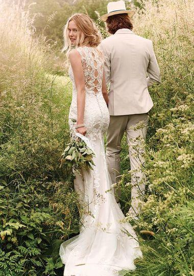Couple walking through tall grass