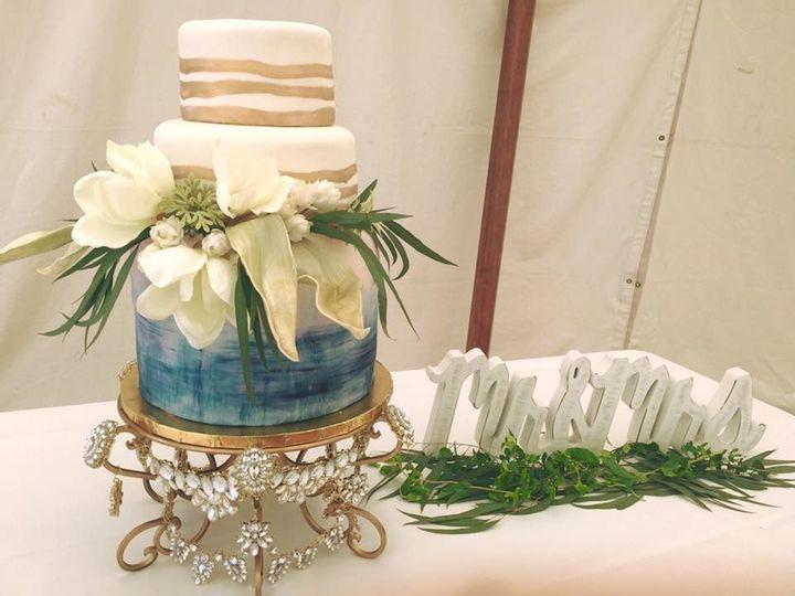 "Modern design for a trendsetting bride. Azure ""watercolor"" on fondant."