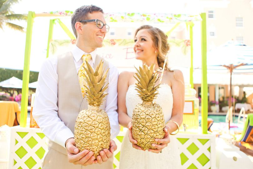 Couple holding pineapple