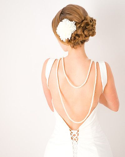 Pearls down the back look stunning with a low backed dress. Paired with a low updo to show off both.