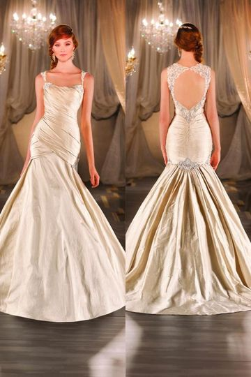 28e72dcad24 403 Silk fit-and-flare designer wedding gown features a tightly ruched  bodice