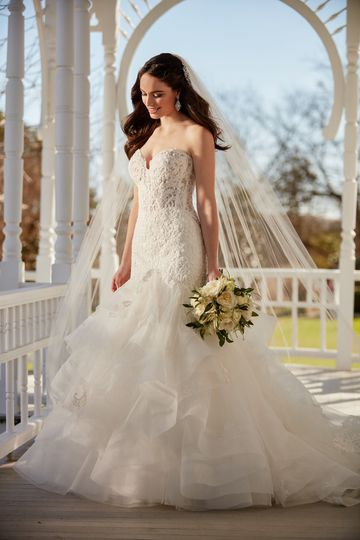 2d8b9c49a65 Martina Liana Style 890 This princess wedding dress from Martina Liana is  adorned with a mix