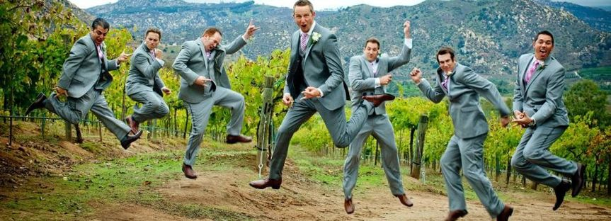 groomsmen jumping silly before wedding ceremony