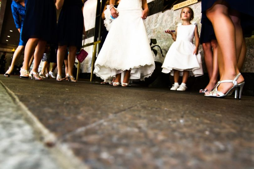Bride with bridesmaids and flower girl