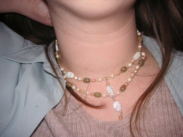 This was one of three prototypes that I designed for a wedding. Contains mother of pearl, autumn...