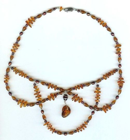 This piece was designed for the bride of a Renaissance style wedding.  Comprised of Amber, Garnet,...