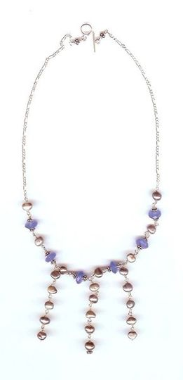 Another style of necklace, with beaded front and finished with sterling silver chain. Necklace...