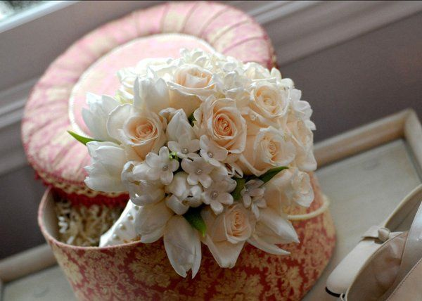 Ivory roses, tulips and pearl-studded stephanotis bouquet
