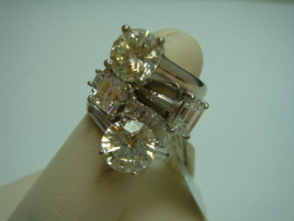 A popular style in the 1950's, this diamond engagement ring features prongs that disguise a round...