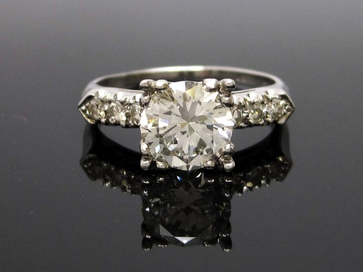 Lovely example of the classic Round diamond engagement ring. Shown is a certified 2+ carat stone....