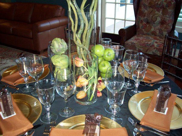 Center Vase- Curly Willow Branches. Lower Vases- Artichokes, Apples & Mango Tulips.