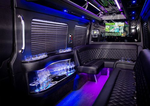 Inside of the 2016 Mercedes Sprinter Coaches--7 foot ceilings, full bar, leather seats, two...