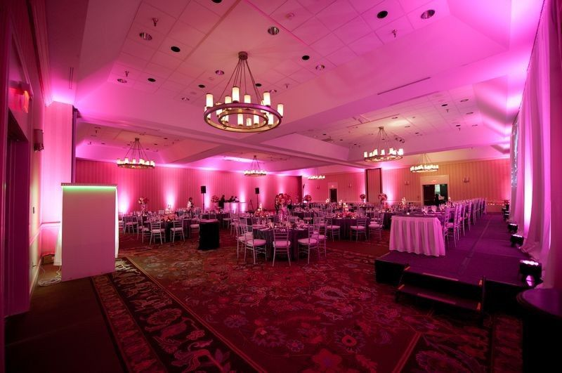 Pink uplighting reception set-up
