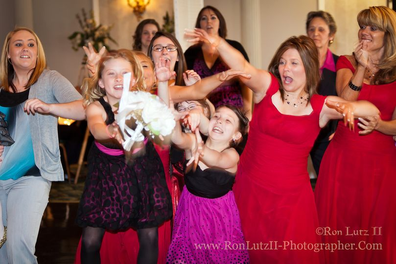 Catching the bouquet is potentially a great action shot!