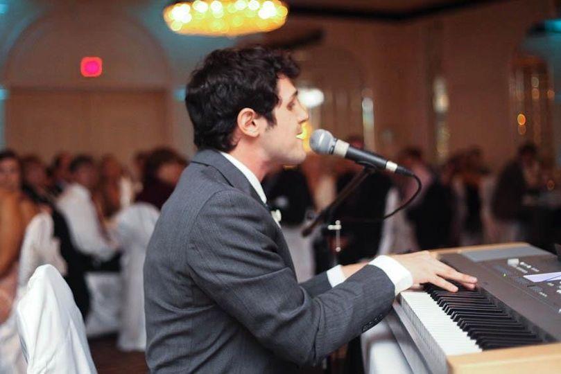 michael jade playing piano at wedding