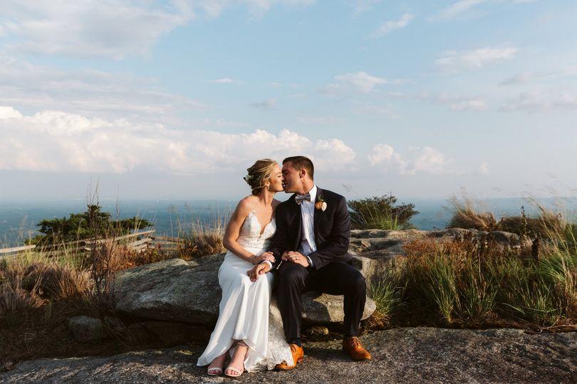 bride groom cliffs glassy kissing sitting 51 908144