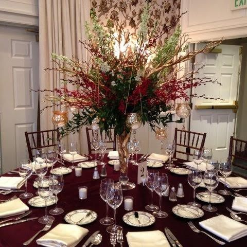 Round table setup with red flowers