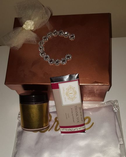 Bridesmaids gifts from the bride. Customized bathrobe, candles, chocolate bar and gift box.