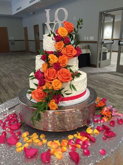 Cascading flowers on wedding cake