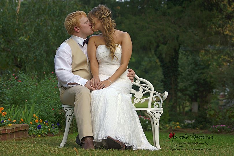 800x800 1455404830997 bride groom kiss bench portrait monroe nc