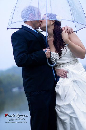 800x800 1455404862258 bride groom kiss under umbrella lake lure