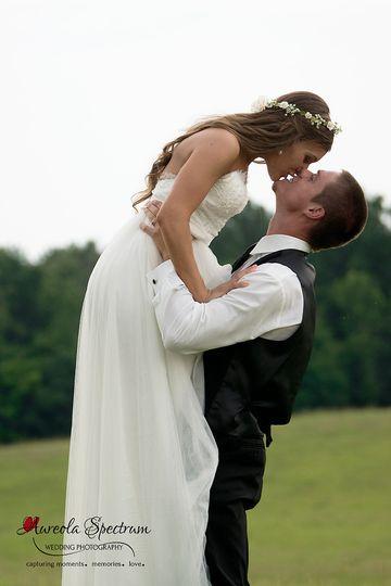 groom lifts bride in field marshville nc 1