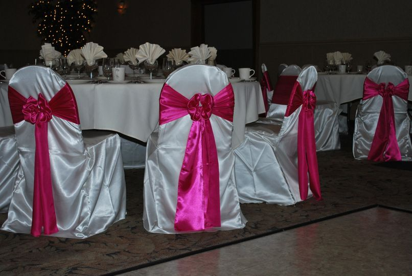 White chairs with pink bows