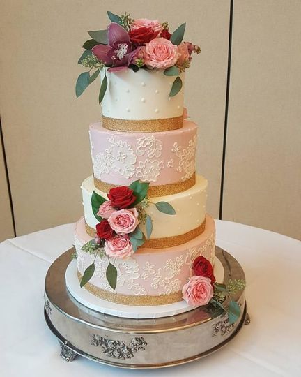 Pink and white cake with rose decorations