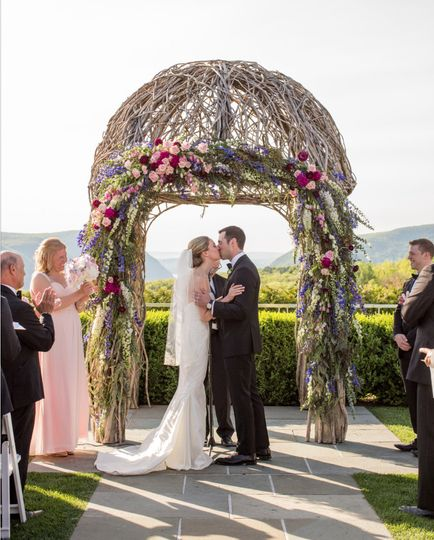 Wedding kiss at the altar