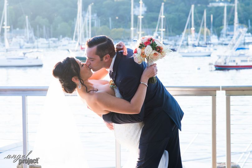 Newlyweds kiss at the dock