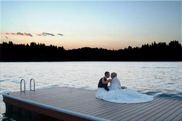 Newlyweds sitting on the boardwalk